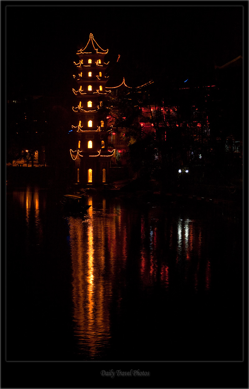 Chinese pagoda at night on river - Fenghuang, Hunan, China - Daily Travel Photos