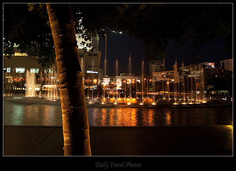 KLCC water fountain night and lighted tree - Kuala Lumpur, Malaysia - Daily Travel Photos