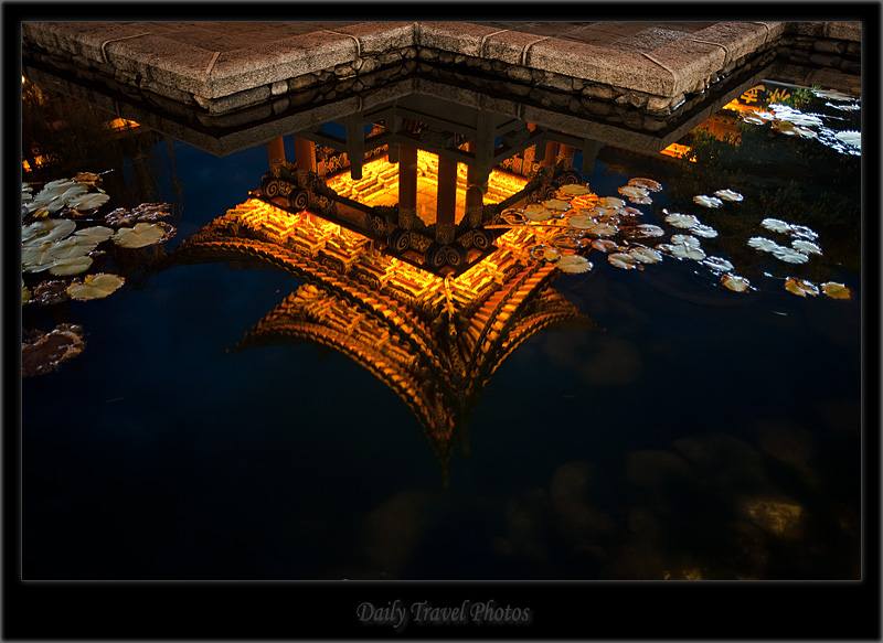 Lily Pads and a pagoda temple are reflected in a water fountain - Dali, Yunnan, China - Daily Travel Photos