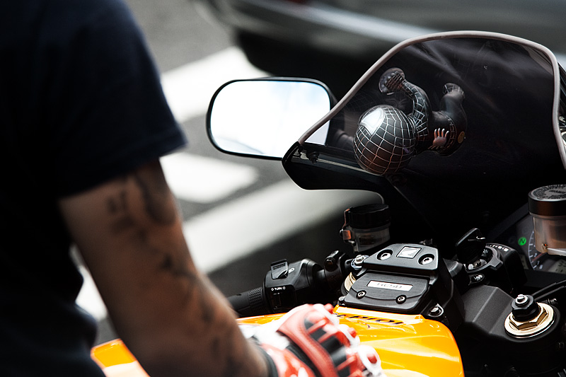 Suction Spider man on motorcycle window - Seoul, South Korea - Daily Travel Photos