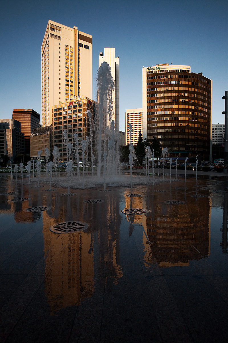 Seoul Plaza Fountain Reflection Downtown - Seoul, South Korea - Daily Travel Photos