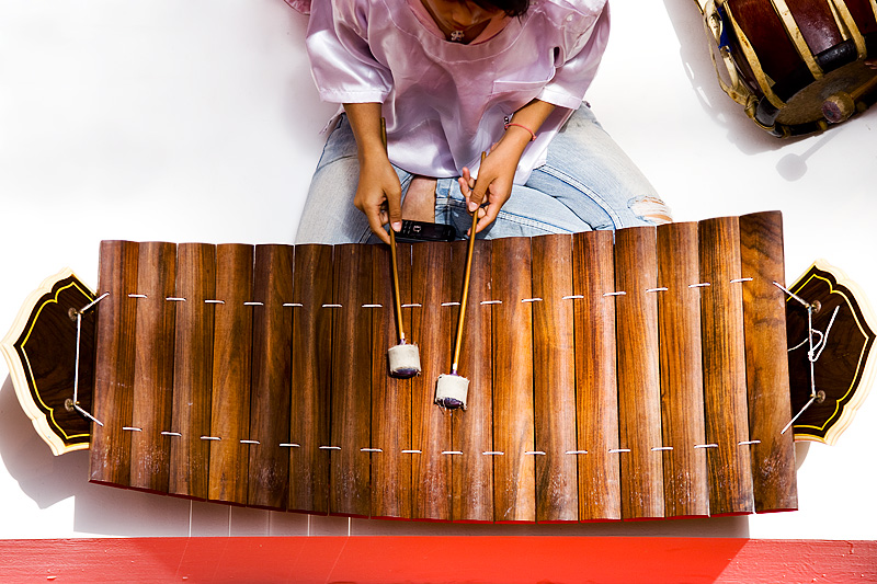 Girl Playing Ranat Ek Thai Traditional Instrument Overhead - Bangkok, Thailand - Daily Travel Photos