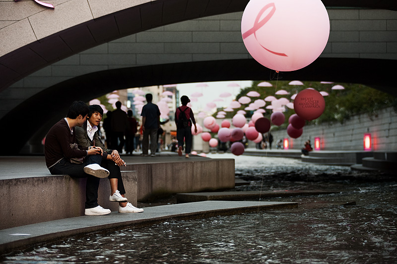 Cheonggyecheon Breast Cancer Awareness Pink Balloons Ribbon Umbrellas Two Boys - Seoul, South Korea - Daily Travel Photos