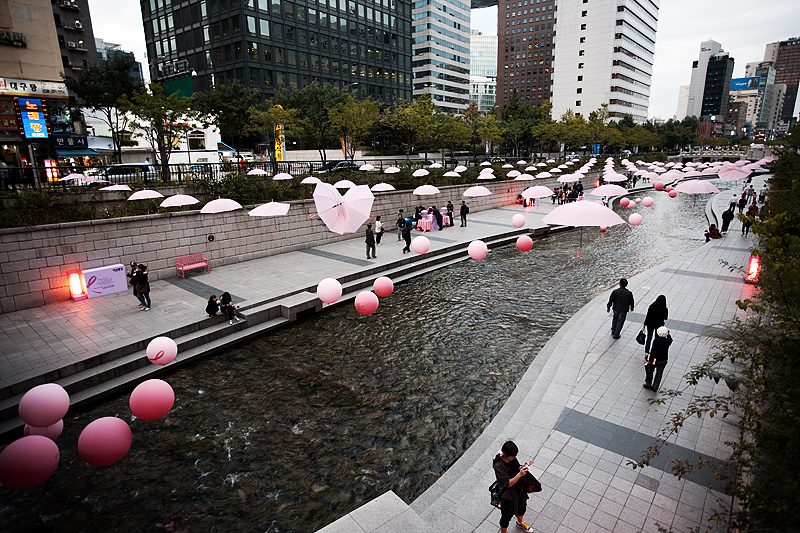 Cheonggyecheon Breast Cancer Awareness Pink Balloons Ribbon Umbrellas Buildings Reverse - Seoul, South Korea - Daily Travel Photos