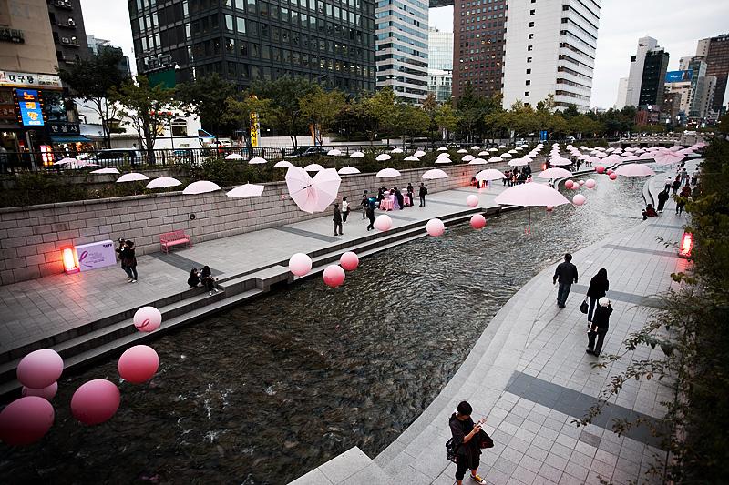 Cheonggyecheon Breast Cancer Awareness Pink Balloons Ribbon Umbrellas Buildings Reverse - Seoul, South Korea - Daily Travel Photos