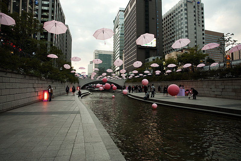 Cheonggyecheon Breast Cancer Awareness Pink Balloons Ribbon Umbrellas Buildings - Seoul, South Korea - Daily Travel Photos