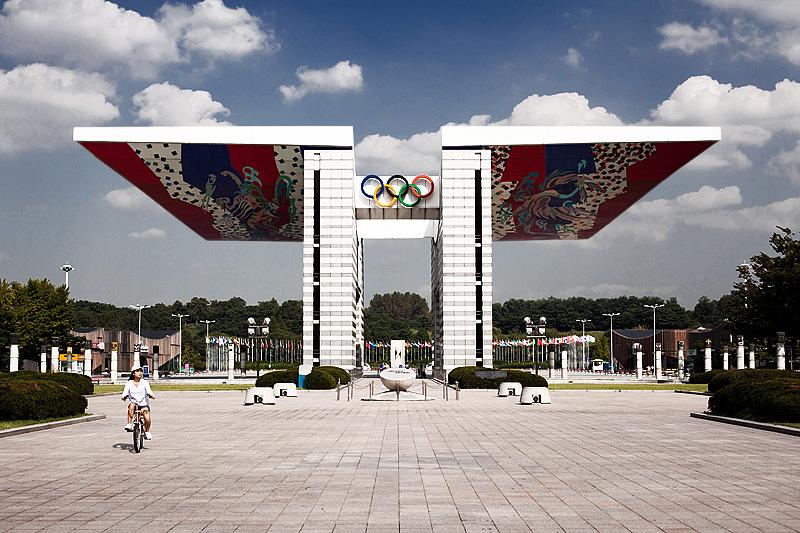 World Peace Gate Olympic Memorial Building Bicyclist Park - Seoul, South Korea - Daily Travel Photos