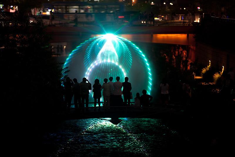 Cheonggyecheon Laser Light Show Digital Canvas Silhouette People - Seoul, South Korea - Daily Travel Photos