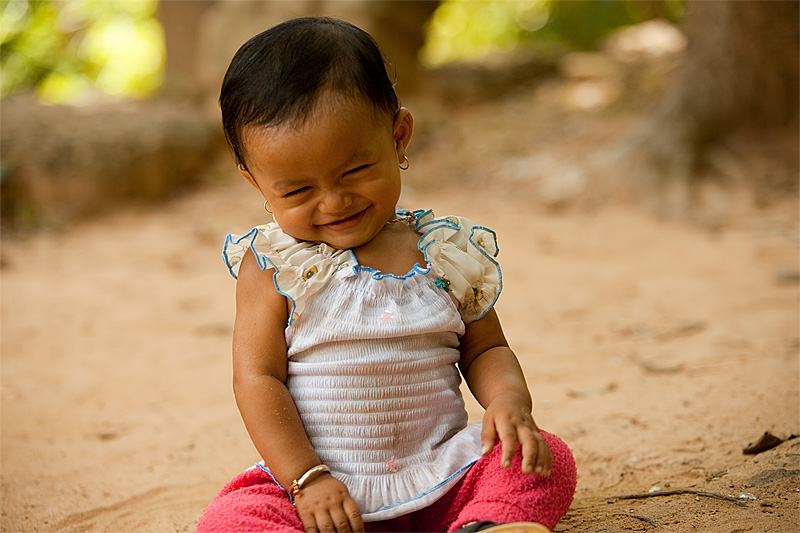 Baby Twisting Finished Smiling Cutest In The World Angkor Wat - Siem Reap, Cambodia - Daily Travel Photos