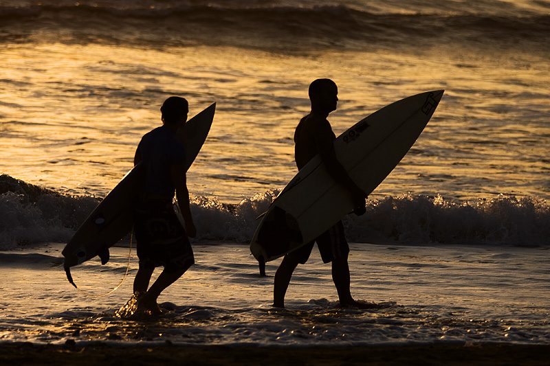 End of Surfing Day Surfers Walking Home - Kuta, Bali, Indonesia - Daily Travel Photos