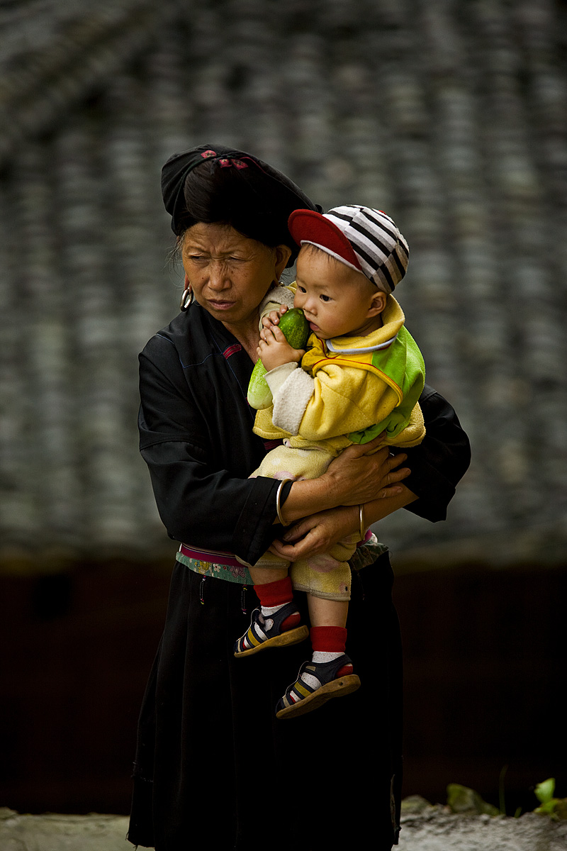 Dragon's Backbone Titian Longji Miao Minority Woman Traditional Clothes Long Earlobes Earring Down Baby - Ping An, Guanxi, China - Daily Travel Photos