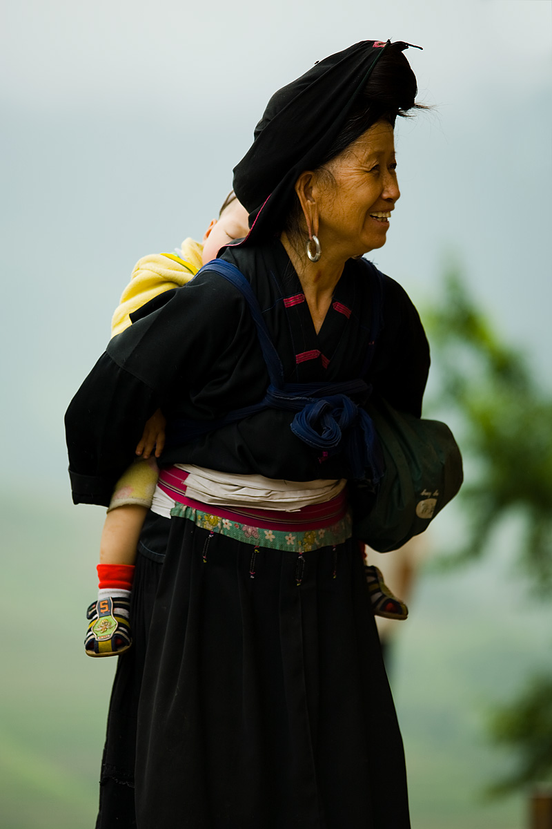 Dragon's Backbone Titian Longji Miao Minority Woman Traditional Clothes Long Earlobes Earring Laughing Baby - Ping An, Guanxi, China - Daily Travel Photos
