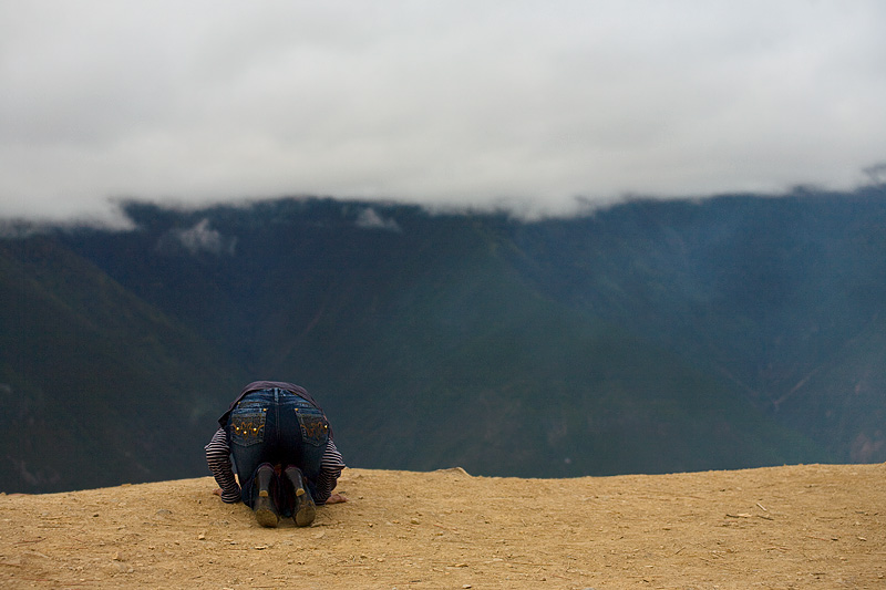 Tibetan Woman Praying Chic Meili Snow Mountain Kneeling - Deqin, Yunnan, China - Daily Travel Photos