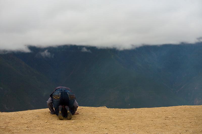 Tibetan Woman Praying Chic Meili Snow Mountain Kneeling - Deqin, Yunnan, China - Daily Travel Photos