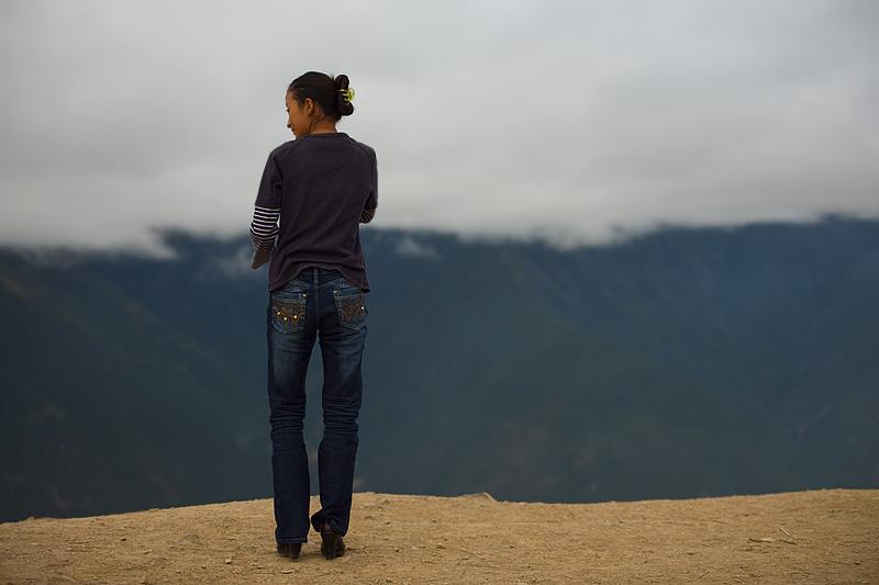 Tibetan Woman Praying Chic Meili Snow Mountain Standing - Deqin, Yunnan, China - Daily Travel Photos