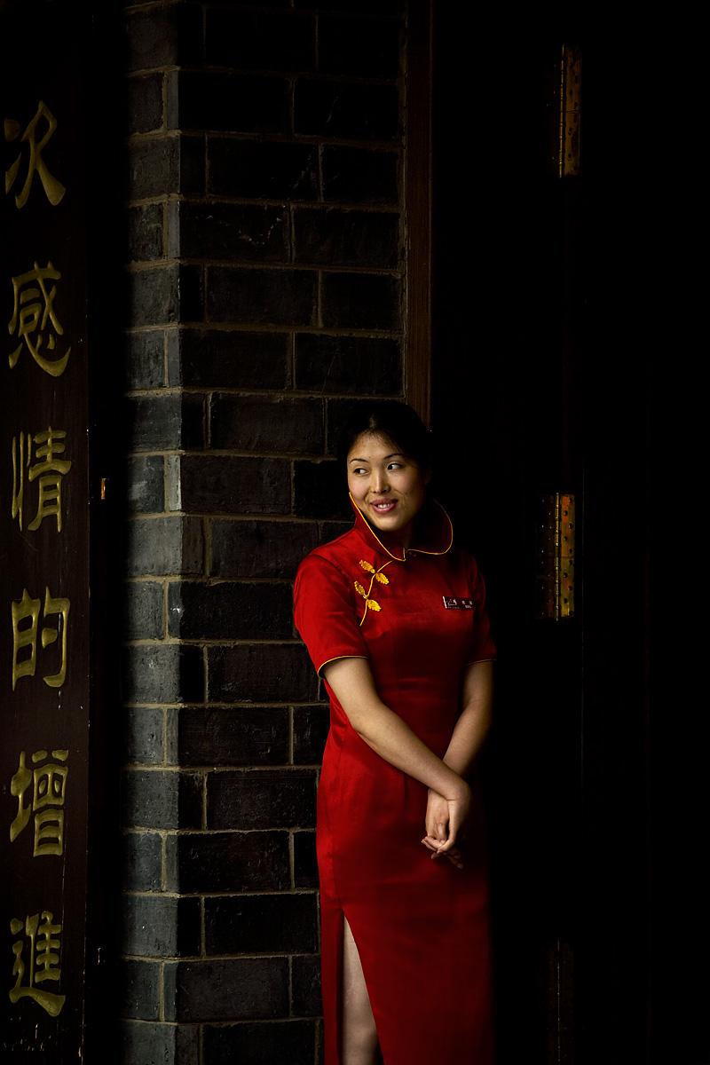 Chinese Woman Red Silk Dress Restaurant Greeter - Kunming, Yunnan, China  - Daily Travel Photos