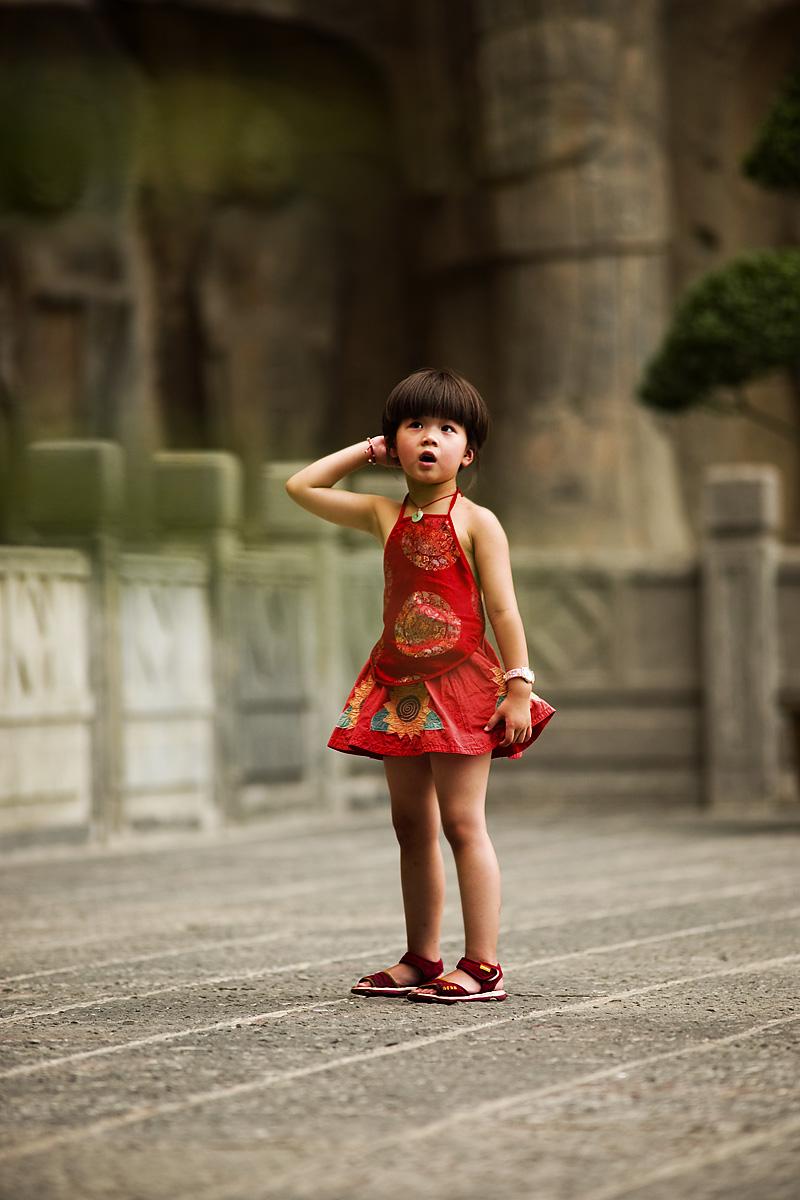 Chinese Girl Red Clothes Bowl Haircut Longmen Shi Buddhist Grottos - Luoyang, Henan, China - Daily Travel Photos