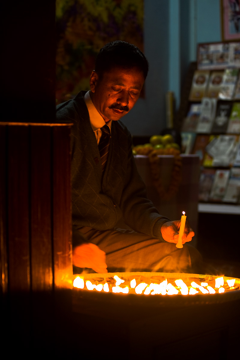 Diwali Festival of Lights Holiday Father Lighting Candles - Kathmandu, Nepal - Daily Travel Photos