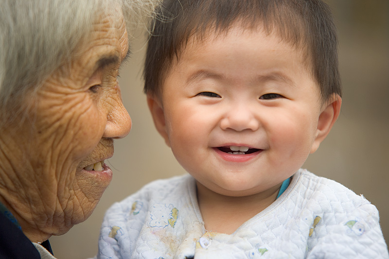 Grandmother Grandson Old Woman Young Child Smiling - Fenghuang, Hunan, China - Daily Travel Photos