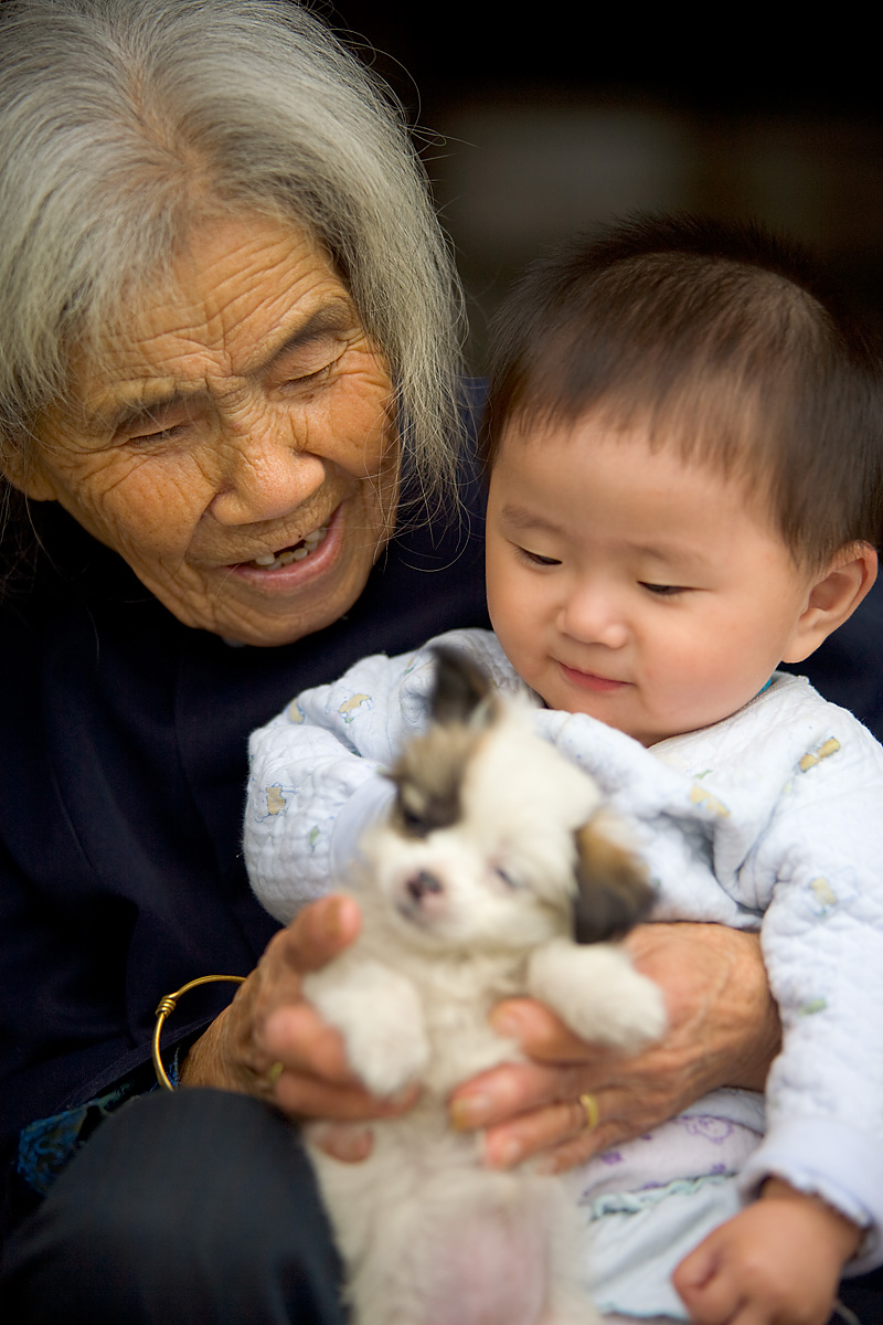 Grandmother Grandson Old Woman Young Child Puppy Shared Moment - Fenghuang, Hunan, China - Daily Travel Photos