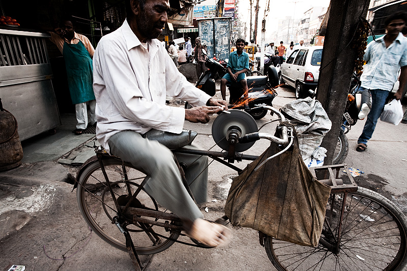 Bicycle Stone Grinder Knife Sharpener Sparks - Delhi, India - Daily Travel Photos