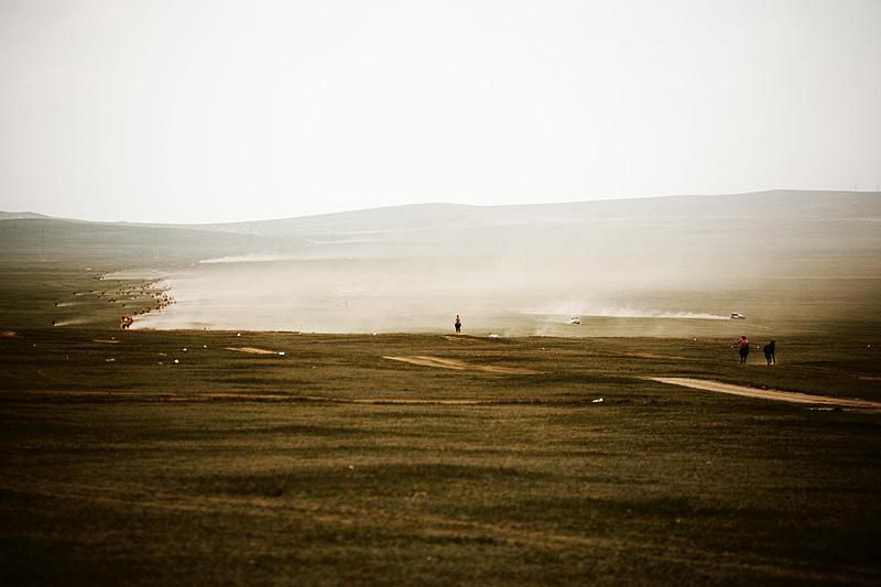 Nadaam Festival Horse Racing Dusty Field Home Last Stretch Leader - Ulaan Baatar, Mongolia - Daily Travel Photos