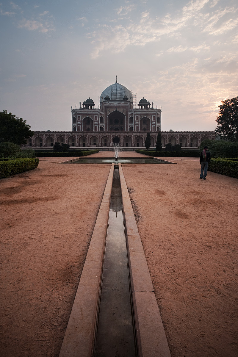 A Local Man Walks Around Humanyun's Tomb at Sunrise Fountain Dome Garden - Delhi, India - Daily Travel Photos