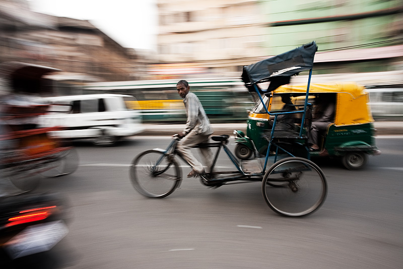 Panning Shot of a cycle rickshaw in downtown traffic - Delhi, India - Daily Travel Photos