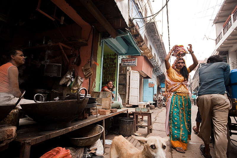 A man dressed as a woman combs the streets of Mathura delivering a message door to door. - Mathura, Uttar Pradesh, India - Daily Travel Photos