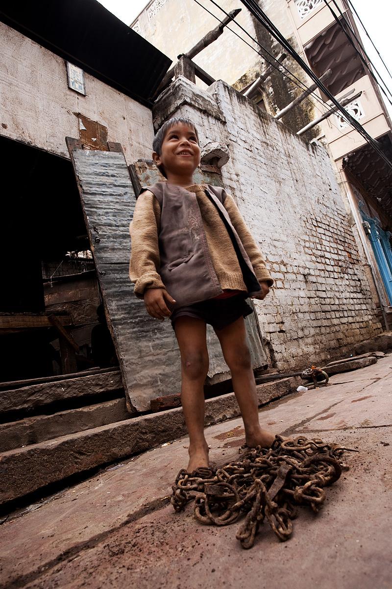 Local boy strongman takes a break from lifting chains. - Mathura, Uttar Pradesh, India - Daily Travel Photos