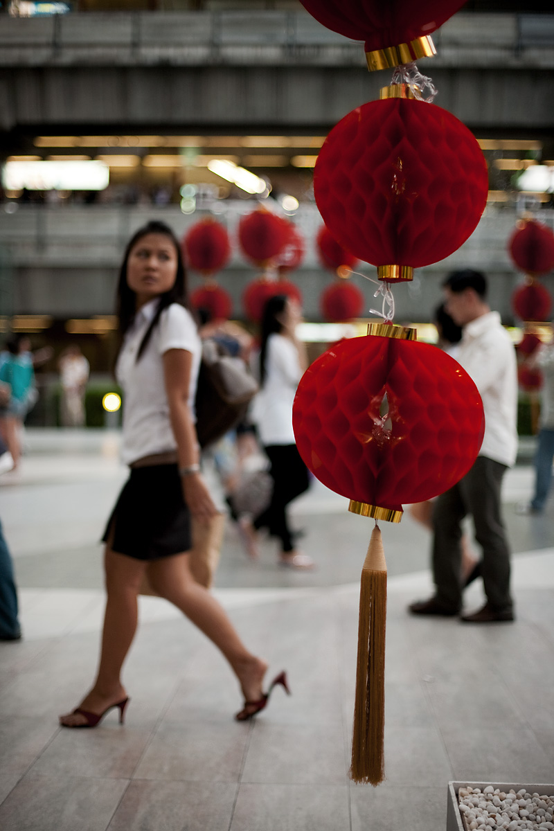 Ornamental red paper lanterns decorate the walkway for Chinese new year at the Paragon Mall. - Bangkok, Thailand - Daily Travel Photos