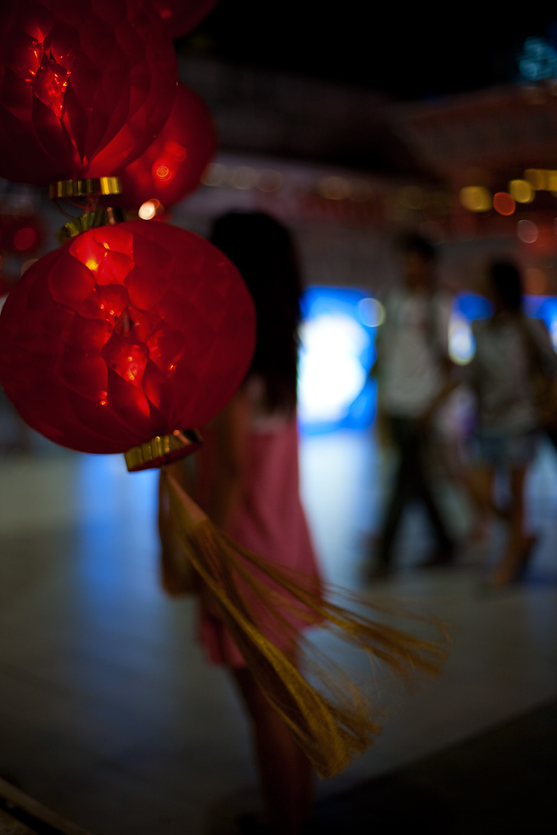 Ornamental paper red lanterns decorate the walkway for Chinese New Year. - Bangkok, Thailand - Daily Travel Photos