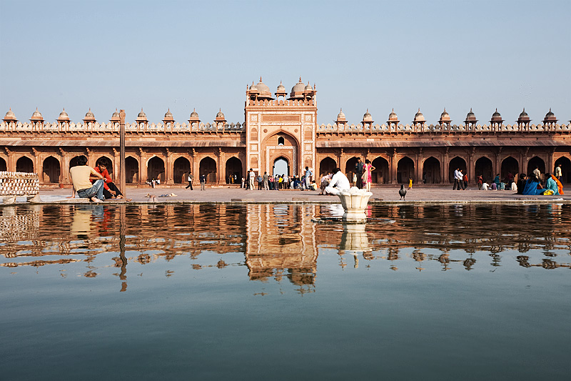 The east entrance of Jama Masjid reflected in the waters of the central foot bath. - Fatehpur Sikri, Uttar Pradesh, India - Daily Travel Photos