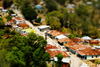Timorese Village Photo: A small village in East Timor rendered in photoshop to recreate a tilt-shift lens effect.
