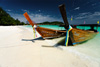 Island Paradise Photo: A white sand beach on a small island off the southern coast of Thailand, typical of the natural beauty all over the country.  These longtail boats are powered by used automobile engines and form a large part of the local transportation around the islands of Thailand.