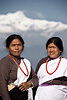Traditional Garments Photo: At the three-day Bandipur festival with the Himalayas as a backdrop, a pair of handsomely-dressed local women graciously pose for a photo.