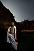 Priest & Cliffs Photo: A young Brahman poses for a strobed photo near the Badami archeological museum.  This boy Brahman was soon to perform pooja (prayers) for the festival of Shivaratri.