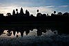Grassy Puddle (Angkor Wat Temples Part I) Photo: Angkor Wat's silhouette reflected in a pool of rainwater.