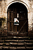 Door Decoration Photo: Chairman Mao hangs precariously by a single nail to a rickety door.