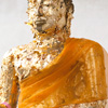 Golden Buddha Photo: A statue of Buddha covered by pilgrims in small sheets of gold leaf.