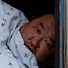 Rude Awakening Photo: My Gobi dessert tour driver's sleeping accommodation is the emptied back of our versatile Jaman Yos, a Soviet era tank of a van.  I suppose his startled reaction is normal for anyone awoken by a 70-200mm lens pointing at his face.  Luckily he's one of the kindest Mongolians I've met and he didn't want to tear my heart out for the rude awakening.
