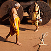 Passersby (Ratha I) Photo: Each full moon, Brahmins climb aboard the small ratha (chariot) to be pulled down the street by a throng of Gokarna villagers, accompanied by drummers and musicians.  Once a year, during the festival of Shivarathri, Brahmins cram into the large ratha pulled through a swarm of humanity, the likes of which is only typically be seen in India.