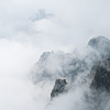 Among the Clouds (Huangshan III) Photo: Early morning or late afternoon, chances are high that you'll be enveloped by wispy clouds that roll gently up Huangshan's steep and craggy sides.