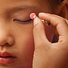 Pink on Pink Photo: Young Miao ethnic minority dancers apply makeup before a performance.