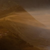 Misty Morning (Caldera I) Photo: Wind sweeps mist from the edge of town into Mt. Bromo's Caldera.