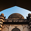 Golgumbaz Photo: A mausoleum for a deceased Muslim ruler, Mohammed Adil Shah.  His wives, mistress and other members of his family are also entombed within. The second photo shows the textured floor of the Golgumbaz lighted by one of the few windows in the massive interior of the building.