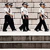 "Out of Step Photo: A group of young ""police"" officers walk in loose formation down Cheonggyecheon (청계천) Stream in Seoul.  Korean residents are obliged to serve in the military but some skirt gun-toting duty by being assigned as civilian police officers."