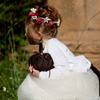 Shadow's Edge Photo: A flower girl rests while the wedding party poses for their contrived snapshots.