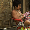 Frugal Travelers Photo: Korean backpacker, Sung Jeh, sews a new bag from scratch in front of his $3/night hut.