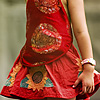 Red Thread Photo: Cute Chinese tourist in a red handkerchief top and skirt.